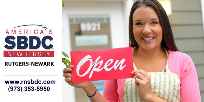 "A woman holding a sign that says ""Open"""