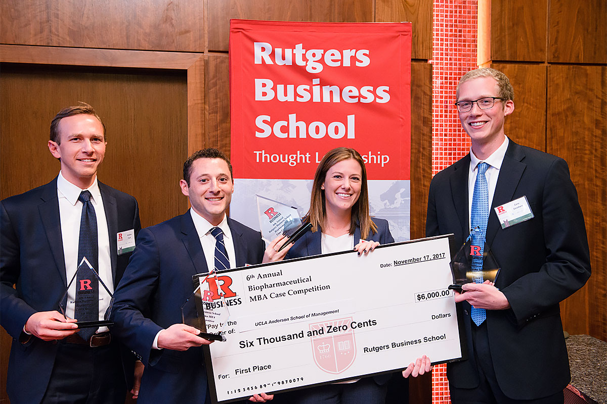 Case competition winner pose with their prize check
